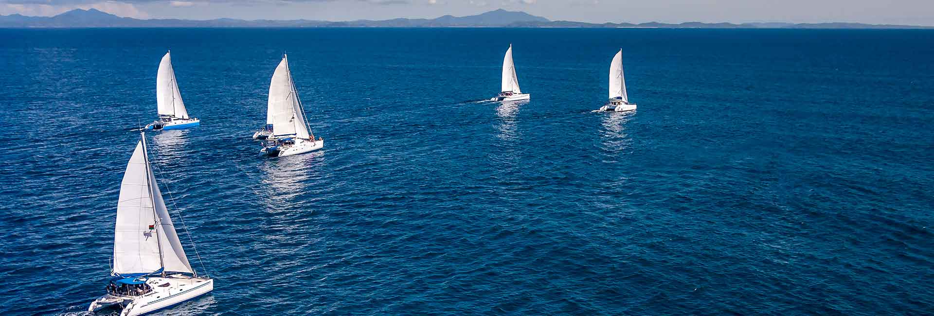 Yachts in the ocean sailing together
