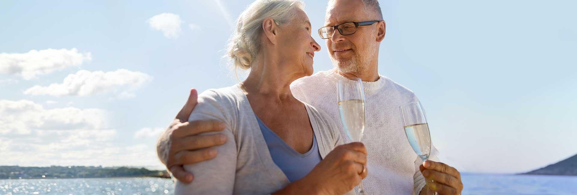 Mature couple enjoying champaign