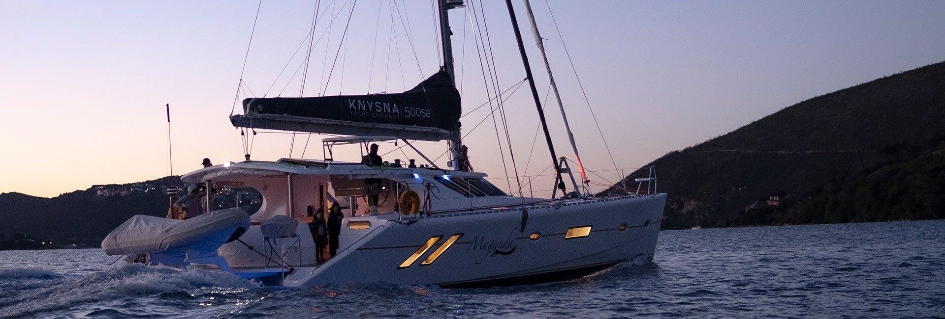 catamaran on water in sunset