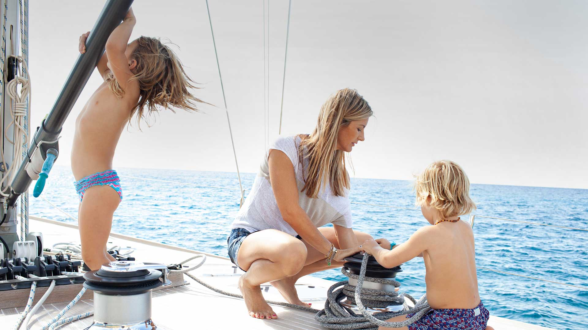 Mother and kids on yacht